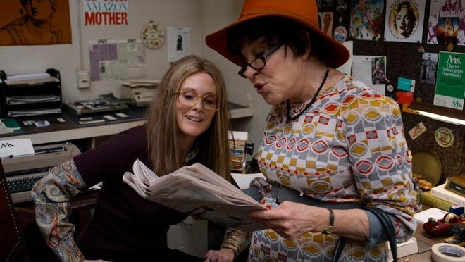 "Julianne Moore, left, as Gloria Steinem and Bette Midler as Bella Abzug in a scene from ""The Glorias."""