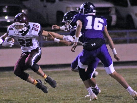 Tularosa's Jacob Paz tries to evade two defenders on
