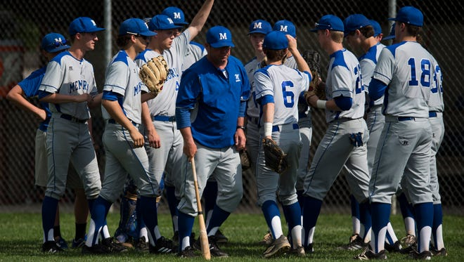 Memorial's team huddles before taking on Harrison at Harrison's baseball field on Thursday, May 10, 2018. The game was postponed due to weather in the second inning.