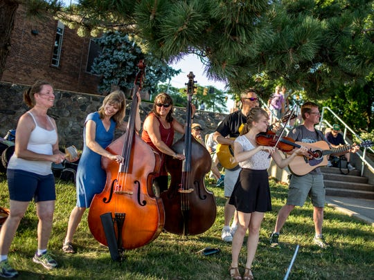 Members of 7th Street perform along the Black River during the 2016 Family Night.