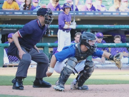 Catholic Central's Matt Stinebiser behind the plate in last year's Catholic League A-B semifinal at Comerica Park.