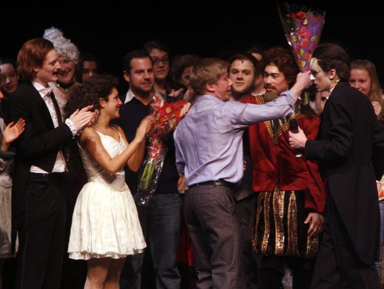 """Director Joe Egan accepts a bouquet after the final curtain of """"Phantom of the Opera"""" at Nyack High School on March 18, 2008."""