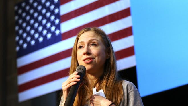 Chelsea Clinton, standing in front of an American flag, speaks to the crowd of 250 people during a campaign rally stop Tuesday, October 25, 2016 at the University of Wisconsin-Stevens Point, in Stevens Point, Wis.
