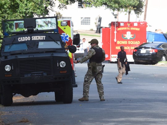 Bomb squad arrives at the scene of a standoff with