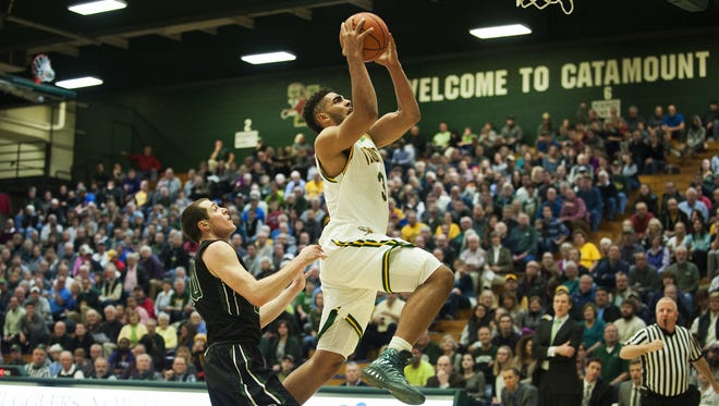 Vermont's Anthony Lamb (3) leaps for a layup during the men's basketball game between the Dartmouth Big Green and the Vermont Catamounts at Patrick Gym  in December.