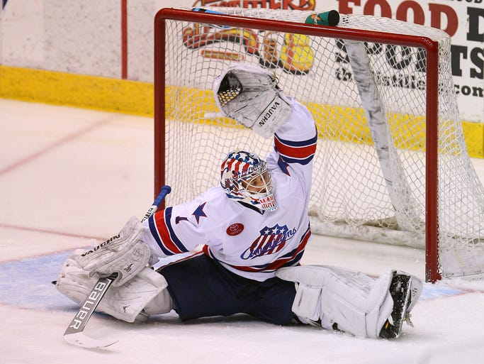 Rochester goalie Andrey Makarov scrambles to make one of his 27 saves against the Marlies on Friday night.