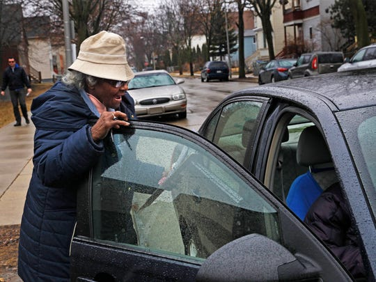 Bettye Coleman finishes up helping a disabled voter with curbside service outside Northcott Neighborhood House, 2460 N. 6th Street. She has been a poll worker and chief inspector for more than 40 years.