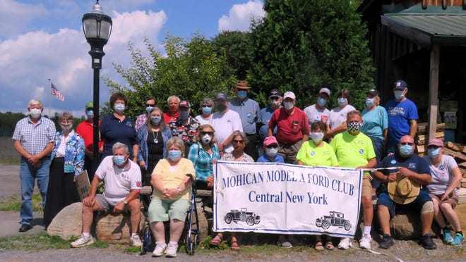 Members of the Mohican Model A Ford Club pose Aug. 22 in front of the Visitor Center at the Great Swamp Conservancy in Canastota.