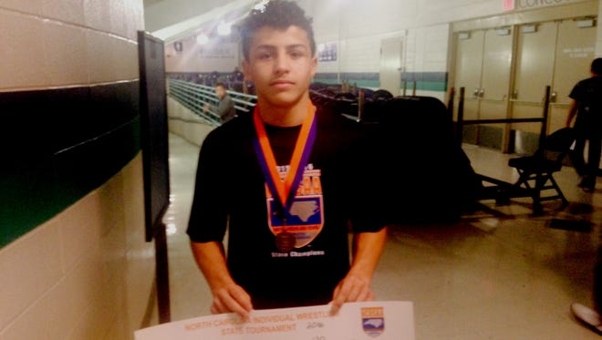 McDowell sophomore Toney McGee won a NCHSAA 4-A wrestling championship on Saturday in Greensboro.