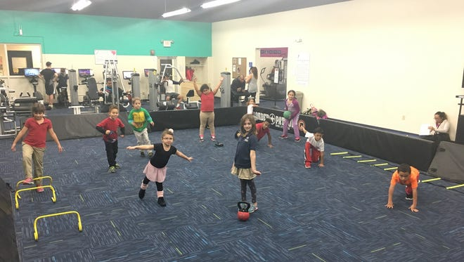 """Children in the YMCA's """"Superheroes in Training"""" class enjoy a fast-paced obstacle course."""