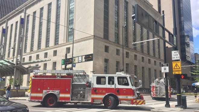 Police and firefighters respond to the Federal Courthouse after security scanned a suspicious item Thursday afternoon.