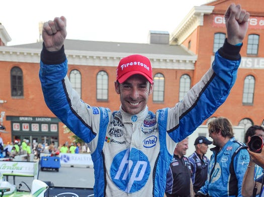 IndyCar Series driver Simon Pagenaud celebrates after winning the Grand Prix of Baltimore. It was his second career win, both of which have come this season.