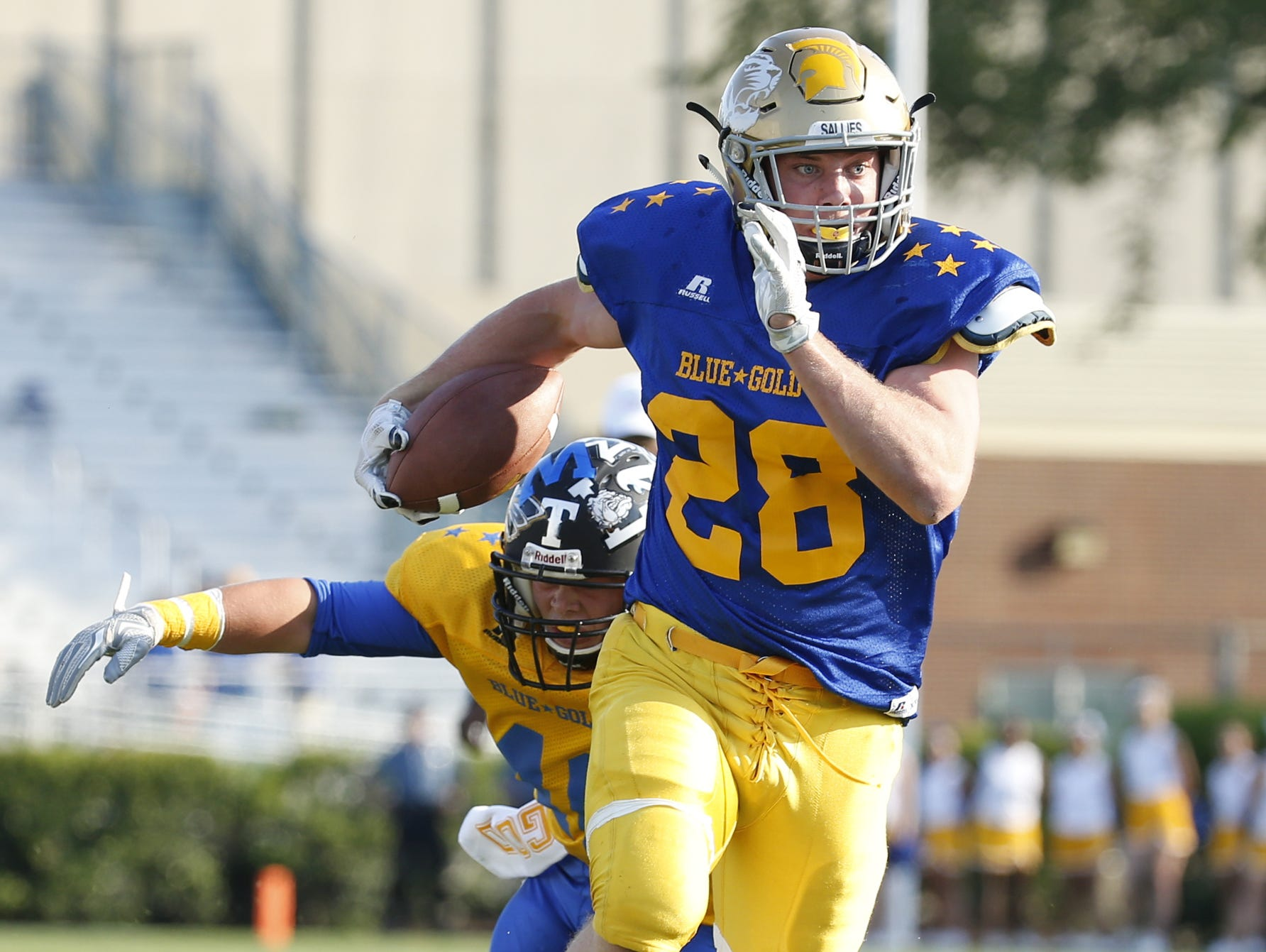 Blue's Colby Reeder of Salesianum gets past the Gold defense for the first of his two touchdowns in the first half of the DFRC Blue Gold All-Star game at Delaware Stadium Saturday. His second came on a Blue-Gold record 100-yard interception return.