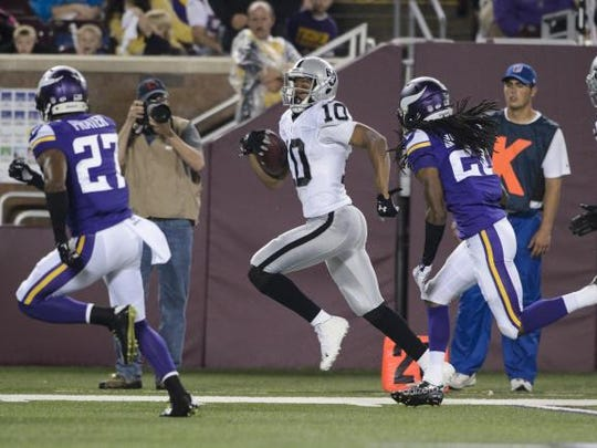 Maclay alum Seth Roberts streaks to the end zone with Minnesota Vikings defenders chasing him. Roberts made the Raiders' 53-man roster after a strong preseason.