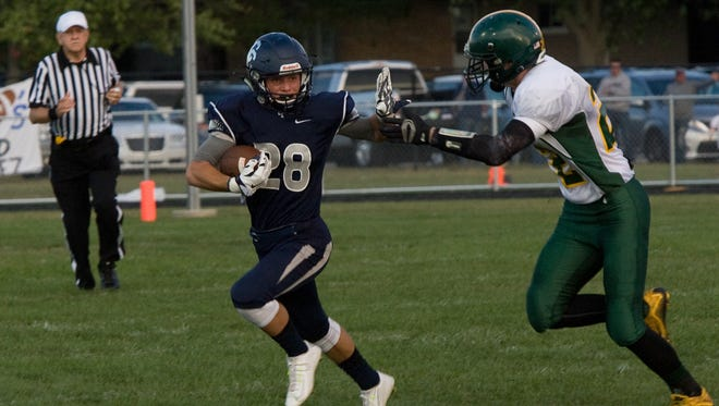 Jordan Turpin of Central Catholic returns the opening kickoff for a touchdown against Benton Central.