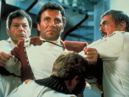 Kirk (William Shatner) is held back as Spock dies in
