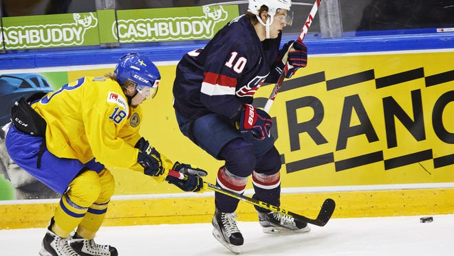 Alexander Nylander of Sweden, left, vies for the puck with Anders Bjork of the USA , during the 2016 World Junior Hockey Championship match between Sweden and USA in Helsinki, Finland, Monday, Dec. 28.