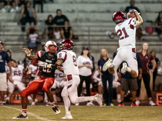 La Quinta's Adam Kasten intercepts a pass intended for Palm Springs Nick Reyes-Foster in the 1st quarter on Friday, September 30, 2016 in Palm Springs.