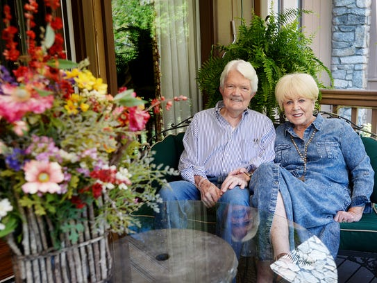Norm and Carole Parks sit on their balcony at Crowfield