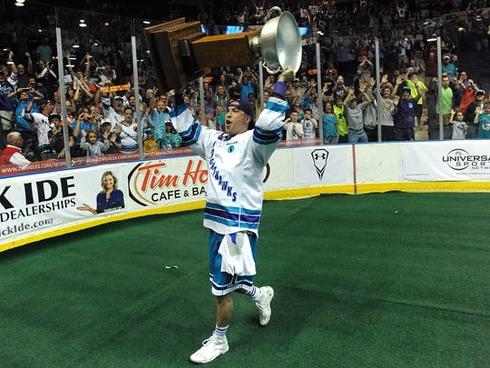 Joe Walters hoists a trophy after the Rochester Knighthawks won their third straight title in 2014.