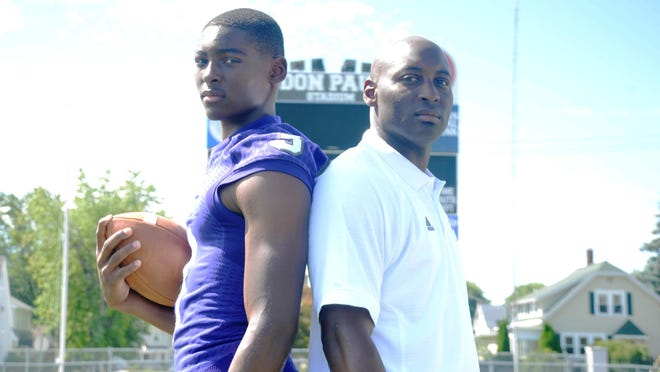 Fremont Ross junior Russ Yeast, left, will follow in the footsteps of his father and coach, Craig Yeast, right, as he recently verbally committed to playing college football at the University of Kentucky.
