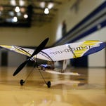 Anthony Burgett, right, flies a quadcopter last Sunday at Jerry A. Conner Fieldhouse in Farmington.