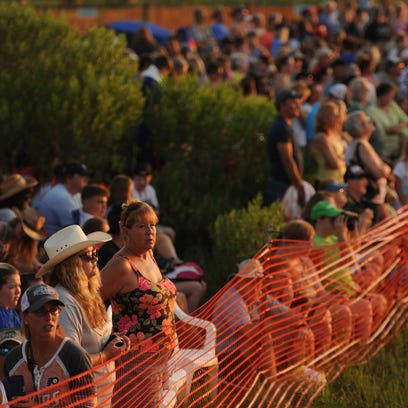 Spectators wait for the 90th annual Chincoteague Pony