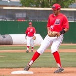 Dixie State first baseman Kevin Kline makes a putout at first base Friday.