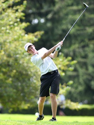 Jackson's Ben Ramold hits his tee shot on the third hole during the Federal League Preseason Tournament at The Elms on Thursday.