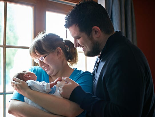 Stephanie and Michael Maguigan with their son Noah.