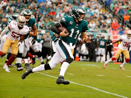 Philadelphia Eagles quarterback Carson Wentz (11) runs the ball during the first half of an NFL football game against the San Francisco 49ers, Sunday, Oct. 29, 2017, in Philadelphia.