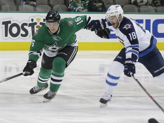 Winnipeg Jets center Bryan Little (18) and Dallas Stars left wing Ryan Garbutt (16) skate for the puck during the first period of an NHL hockey game Tuesday, Dec. 9, 2014, in Dallas. (AP Photo/LM Otero)