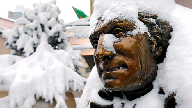 Snow covers a statue of George Washington in Beaver Creek, Colo., on Dec. 4, 2013.