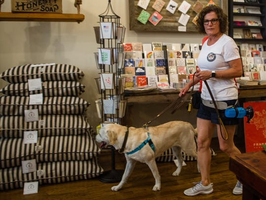 Lacy Paich of Franklin browses White's Mercantile in downtown Franklin, Tenn., with her dog Bella on Friday, June 16, 2017.