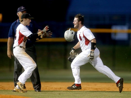 Stewarts Creek's Austin Steel, right, tosses his helmet to designated runner Jake Alexander after hitting a double against Columbia Central on Monday, May 15, 2017.