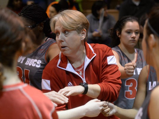 Haughton head coach Jennifer Pesnell gets her team fired up between periods.
