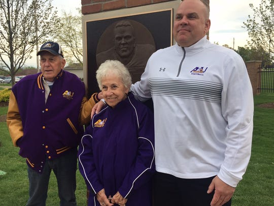College Football Hall of Famer Bill Royce with his parents, Jim and Millie, after Ashland University dedicated a pillar in his honor before last Saturday's spring game.