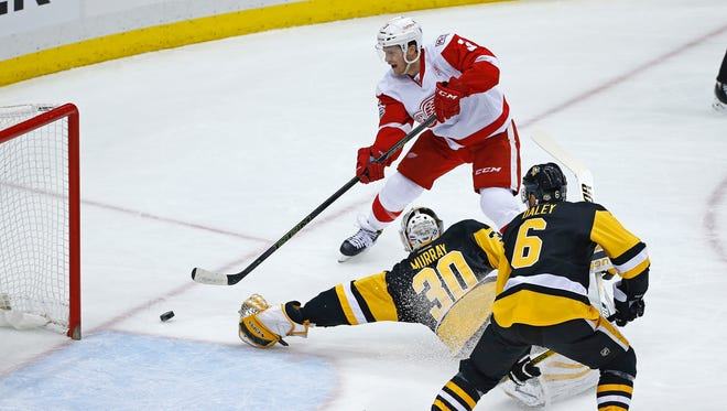 The Detroit Red Wings' Nick Jensen scores on Pittsburgh Penguins goalie Matt Murray in the first period.