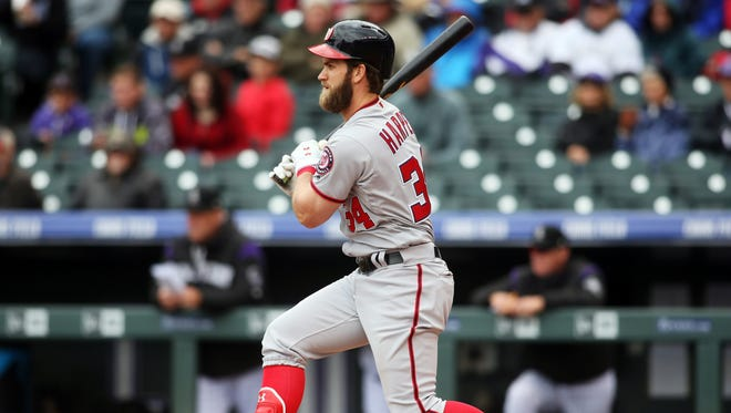 Washington Nationals right fielder Bryce Harper at bat during the third inning against the Colorado Rockies at Coors Field.