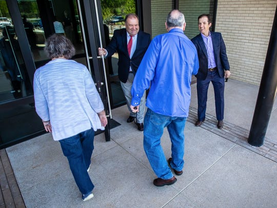 City of Murfreesboro Mayor Shane McFarland, right, and holding the door City of Murfreesboro Interim City Manager Jim Crumley, greet a couple attending the new Murfreesboro Police Department headquarters open house.