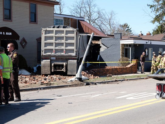 A truck driver crashed his rig into a building April 20 after hitting several other vehicles in the area of Waldon and M-15 in Clarkston.