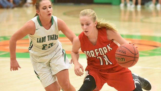 Norfork's Macy Dillard dribbles against Valley Springs' Callie Ray during the Lady Panthers' 63-50 victory over the Lady Tigers on Tuesday night.
