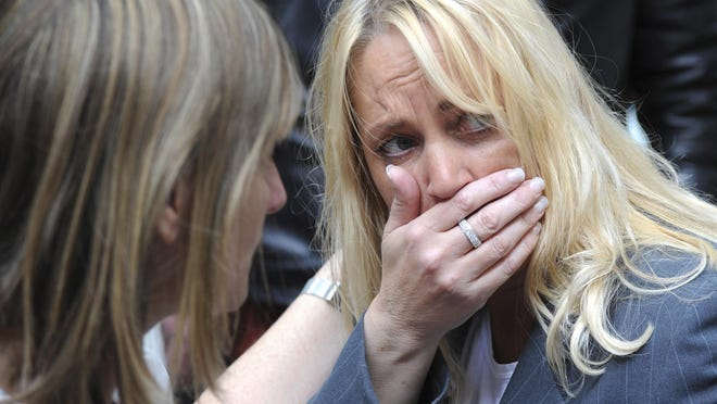 A member of the public reacts as police evacuate the Arndale shopping centre, in Manchester, England Tuesday May 23, 2017, the day after an apparent suicide bomber attacked an Ariana Grande concert as it ended Monday night, killing over a dozen of people among a panicked crowd of young concertgoers. (AP Photo/Rui Vieira)