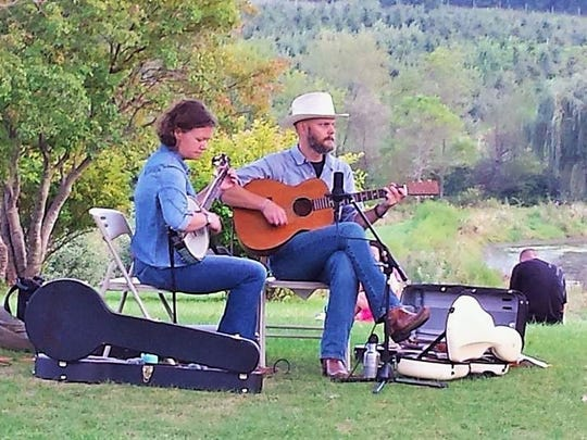 Brandi and Marc Janssen are shown performing at an event at scenic Wilson's Orchard north of Iowa City.