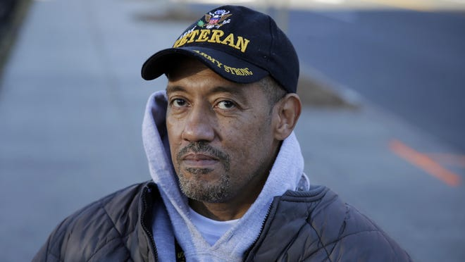 U.S. Paralyzed Army veteran Gene Laureano wears an Army veteran cap Wednesday, Dec. 16, 2015, in Bronx, N.Y. The Department of Veterans Affairs has agreed to pay for robotic legs that could allow scores of paralyzed veterans with spinal cord injuries to walk again. (AP Photo/Mel Evans)