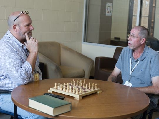 Sam Lott, left, talks with Troy Bishop at the In-House Recovery men's dorm on the Haven for Hope campus in San Antonio.
