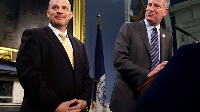 New York City Mayor Bill de Blasio, right, and President of the United Federation of Teachers Michael Mulgrew participate in a news conference at City Hall in New York on Thursday.