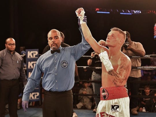Chaise Nelson has his hand raised in victory after scoring a unanimous decision over Jordan Peters in their featherweight bout in Philadelphia on June 24.