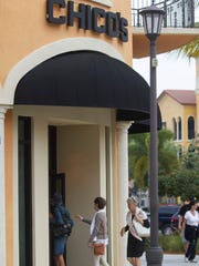 Customers enter the Chico's at Coconut Point in Estero on Thursday.