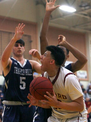 Mason Johnson (center) and Oxnard teammate Brycen Wight were named the top boys basketball players in the Pacific View League.